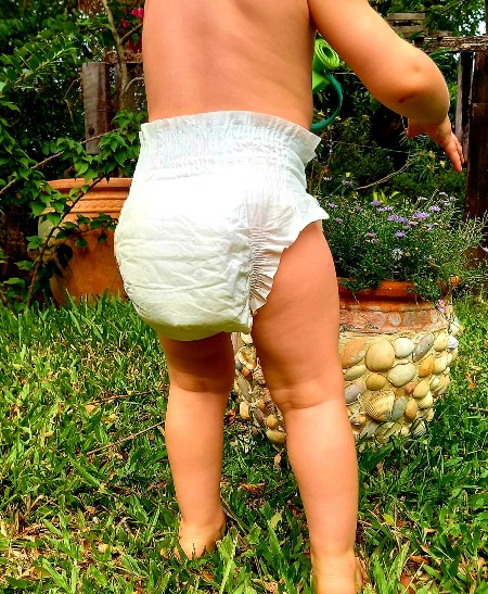 Best compostable nappies in Australia-baby wearing a white eco nappy