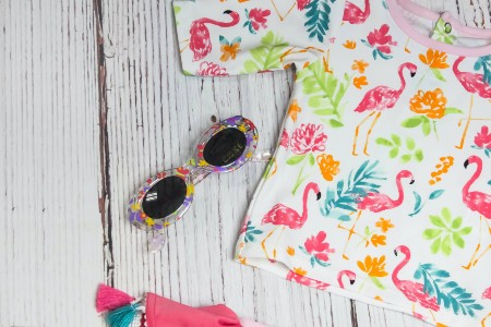 Sell back baby clothes-Swimming shirt with short sleeves and pink flamingo's and a pair of sunglasses as well.