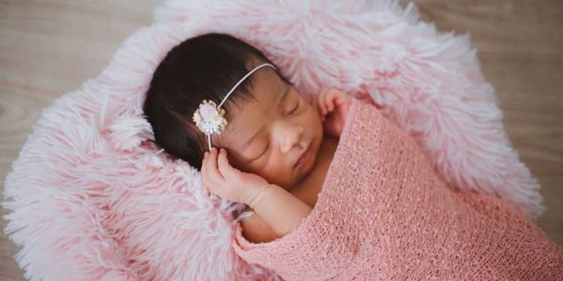 Unique Organic baby clothes-Newborn baby girl wearing a hairband and pink wrap