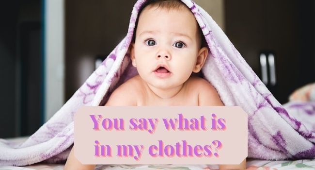Best infant baby clothes-Baby with blankly over hair holding a sign.