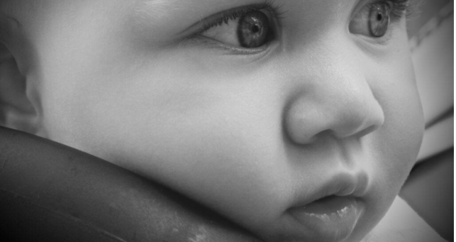 Best infant baby clothes-Close up from a baby face.