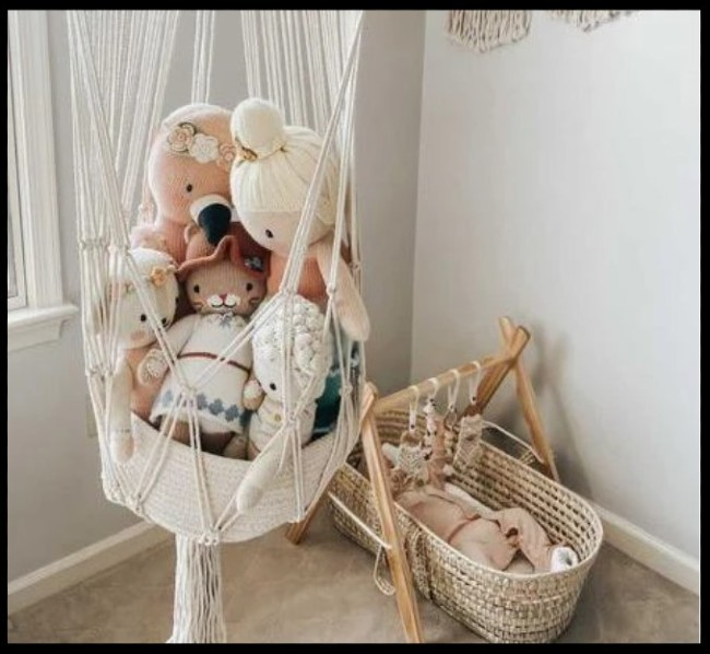 Top rated baby toys-Macrame toy basket filled with organic soft toys.