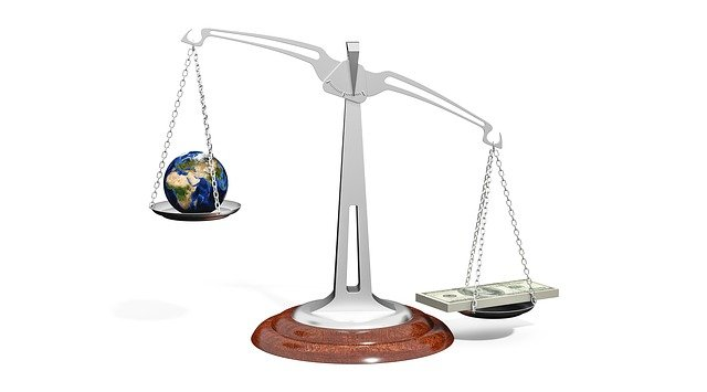 What's in the Honest Diapers?-Set of scales weighing money against world.