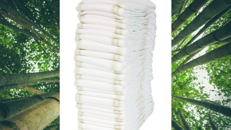 What's in Bambo Nature?-Bamboo forest and a pile of white disposable nappies.
