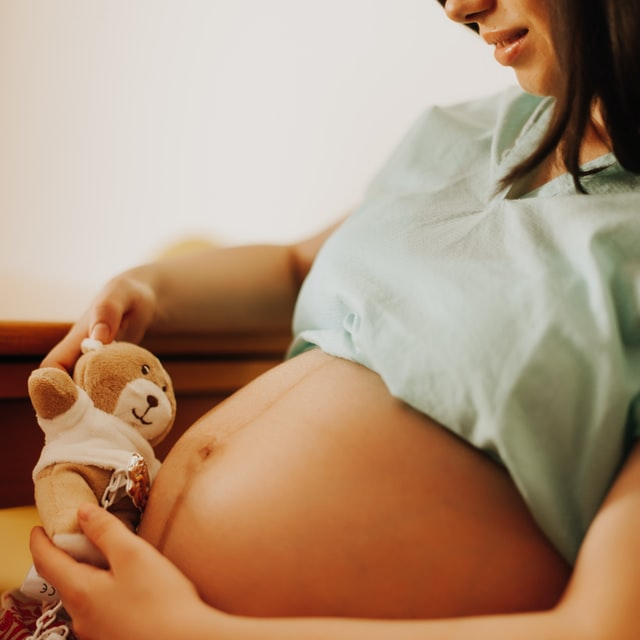 What's in Bambo Nature?-Pregnant lady holding a little teddy.