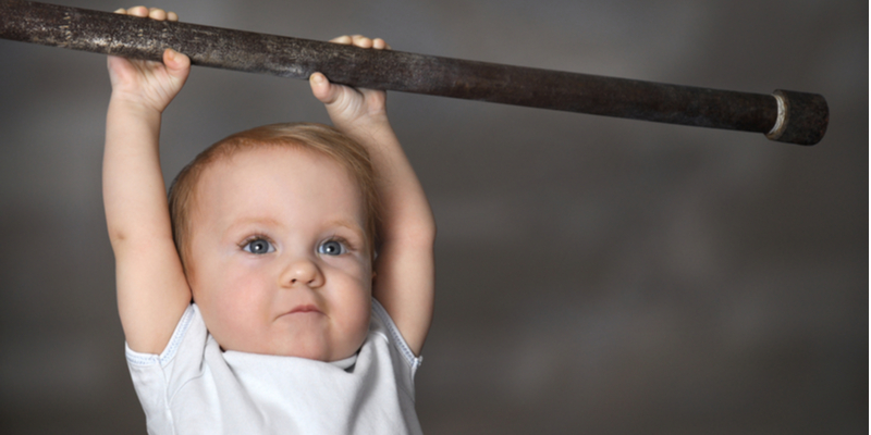 What's a baby Gym?-Strong toddler playing sports.