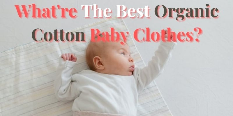 What're the best organic cotton baby clothes?- Newborn laying on white swaddle wearing a white outfit.