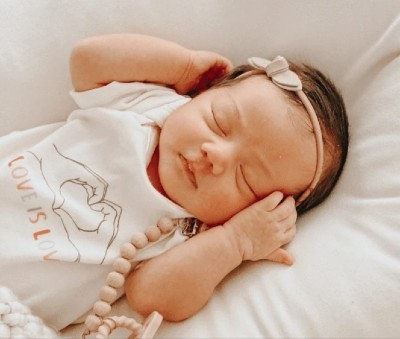 Is Finn Emma fashionable?-Newborn baby wearing bodysuit from the Jamie-Lynn Sigler graphic collection.