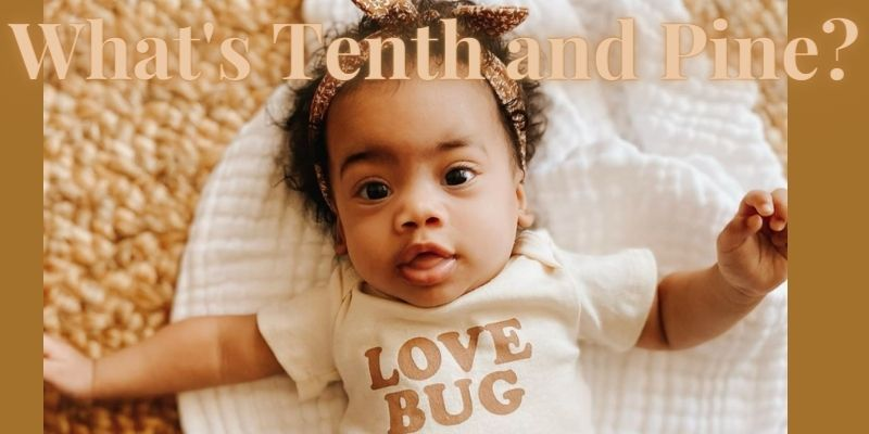 What's Tenth and Pine?- Baby wearing Tenth and Pine bodysuit 'love bug'.