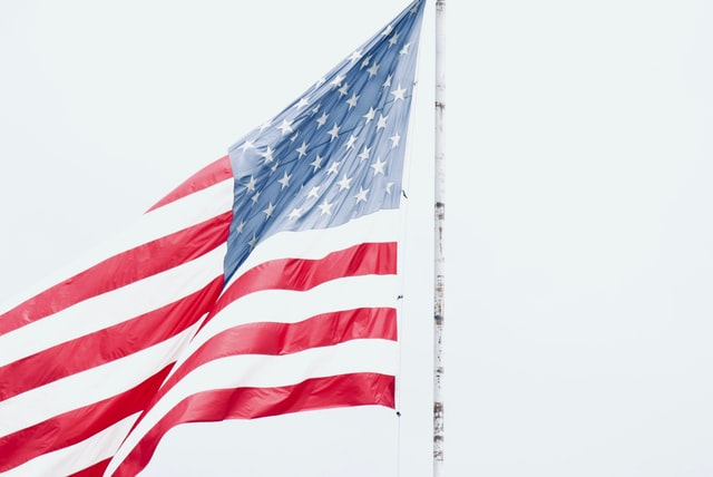 Organic baby clothes made in the U.S.A-Flag of U.S.A on pole.